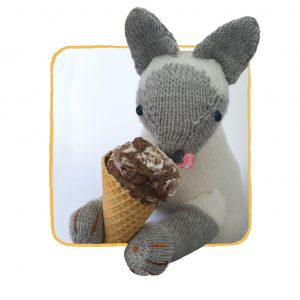 Clarabella the knitted cat licking gelato